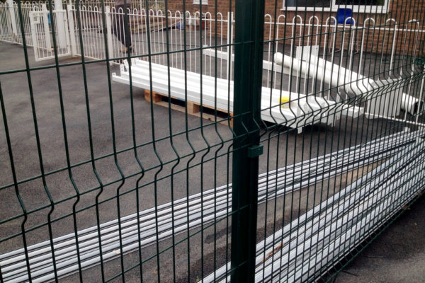 Mesh panel fence close and hairpin railings